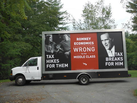 A Mobile Billboard Of A Political Campaign out on the streets to be seen by a multitude of people.